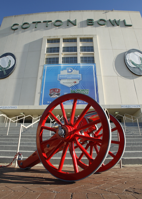 The Fremont Cannon sits in front of the Cotton Bowl in Dallas before UNLV gets it's team photo taken Tuesday, Dec. 31, 2013. UNLV will play North Texas in the Heart of Dallas Bowl on Wednesday. (J ...