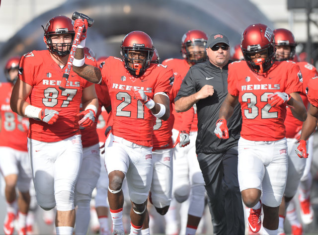 The UNLV Rebels run onto the field at Sam Boyd Stadium on Saturday, Nov. 26, 2016. (Brett Le Blanc/Las Vegas Review-Journal)