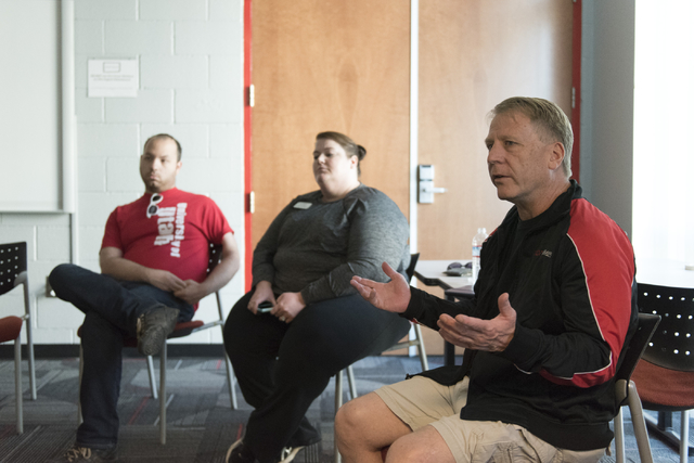 Tom Sedgwick, assistant director for residential life with UNLV, right, speaks with students during a forum held at the school for UNLV students to discuss the outcome of the presidential election ...
