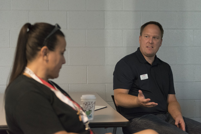 Jon Tucker, director of student union and event services with UNLV, right, speaks with student Allee Brooks during a forumheld at the school for students to discuss the outcome of the presidential ...