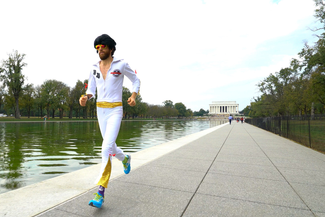 Michael Wardian runs in Washington D.C. dressed as Elvis. He will compete in the Rock 'n' Roll Las Vegas Marathon this weekend wearing the costume. (Rock 'n' Roll Marathon Series).