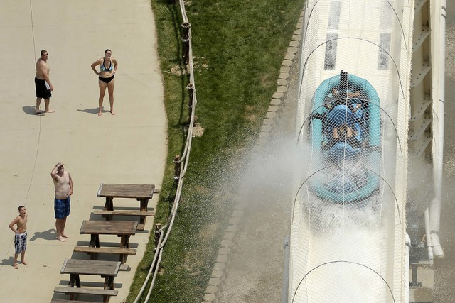 """Riders are propelled by jets of water as they go over a hump while riding a water slide called """"Verruckt"""" at Schlitterbahn Waterpark in Kansas City, Kan.,  July 9, 2014. A 10-year-old boy died Sun ..."""