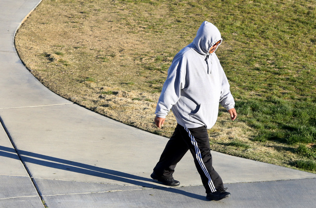 A man bundled up against the cold weather walks in Charlie Frias Park on Tuesday, Nov. 29, 2016, in Las Vegas. (Bizuayehu Tesfaye/Las Vegas Review-Journal Follow @bizutesfaye)