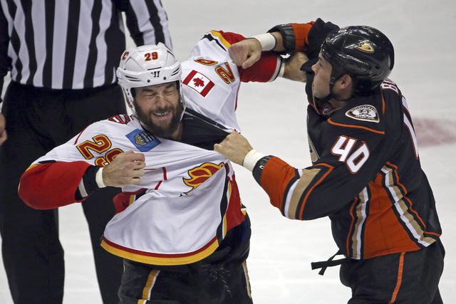 Anaheim Ducks right winger Jared Boll (40) and Calgary Flames defenseman Deryk Engelland (29) fight in the first period of an NHL hockey game in Anaheim, Calif., Sunday, Nov. 6, 2016. (AP Photo/Re ...