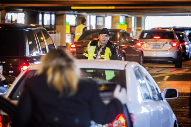 Ground transit technician Eduardo Dorantes directs traffic in passenger pick up  at McCarran International Airport on Wednesday, Nov. 25, 2015. (Jeff Scheid/ Las Vegas Review-Journal) Follow @jlscheid