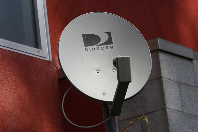 A DirecTV satellite dish is seen on an apartment wall in Los Angeles. (REUTERS/Jonathan Alcorn)