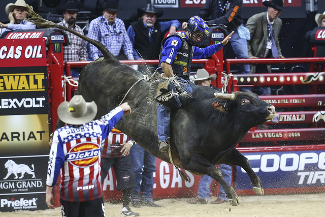 """Kaique Pacheco rides """"Organized Crime"""" while competing in the opening round of the Professional Bull Riders World Finals at the T-Mobile Arena in Las Vegas on Wednesday, Nov. 2,  ..."""