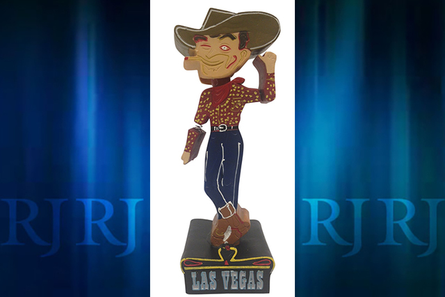 "The National Bobblehead Hall of Fame and Museum rolled out a bobblehead for the iconic Fremont Street cowboy ""Vegas Vic"" this week. The 40-foot neon sign depicting a cigarette-smoking cowboy has b ..."