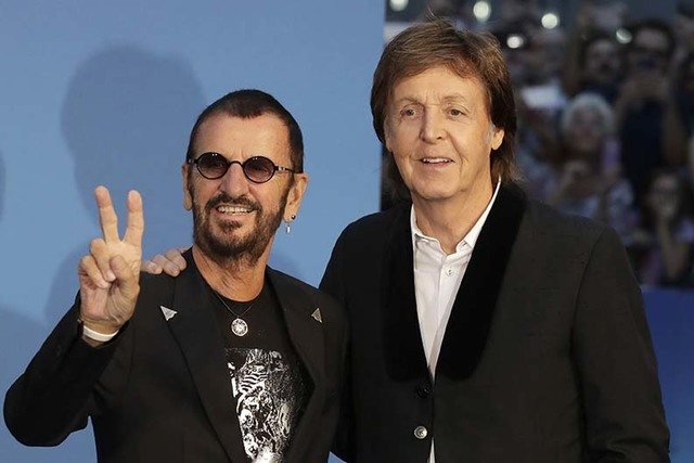 Musicians and members of the Beatles, Paul McCartney, right, and Ringo Starr pose for photographers upon arrival at the World premiere of the Beatles movie, Ron Howard's 'Eight days a week-the tou ...