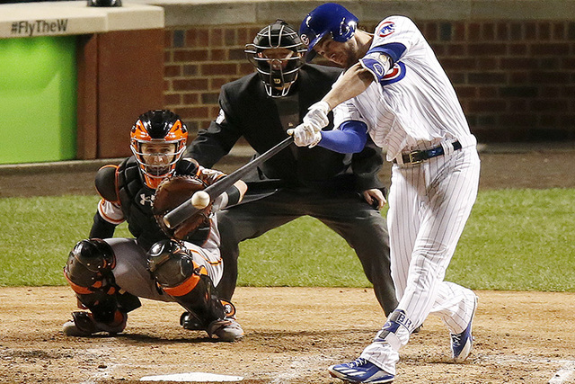 Chicago Cubs' Kris Bryant hits a double in the fourth inning of Game 1 of baseball's National League Division Series against the San Francisco Giants, Friday, Oct. 7, 2016, in Chicago. (AP Photo/C ...