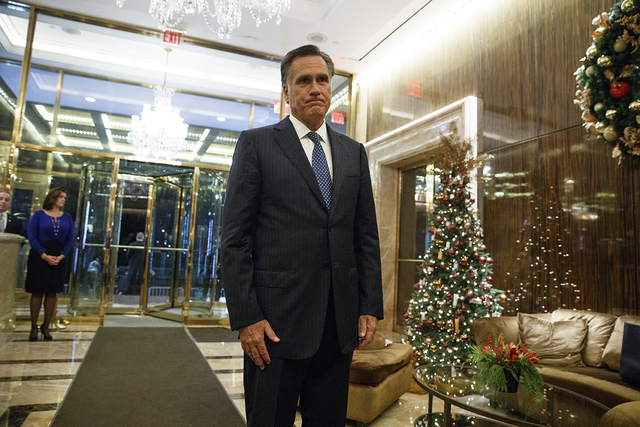 Former Republican presidential nominee Mitt Romney talks with reporters after eating dinner with President-elect Donald Trump at Jean-Georges restaurant, Tuesday, Nov. 29, 2016, in New York. (AP P ...