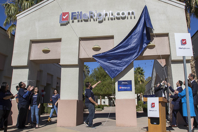FileRight.com employees and other dignitaries unveil the company's new marquee during the grand opening of FileRight's Henderson office on Monday, Nov. 14, 2016. (Richard Brian/Las Vegas Review-Jo ...