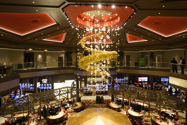 Hand blown 2.5 story, 1.25 ton glass dragon sculpture hangs over the casino in the Lucky Dragon hotel-casino, 300 W. Sahara Ave., on Friday, Nov. 18, 2016. Las Vegas' newest casino, which will cat ...