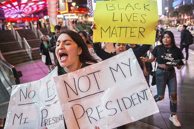 "Nataly Ramos marches with a crowd of anti-Trump protesters chanting ""Not my president"" on the Strip on Wednesday, Nov. 9, 2016, in Las Vegas. (Benjamin Hager/Las Vegas Review-Journal)"
