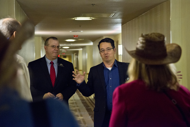 Kenji Hall, the assistant manager of Primm Valley Casino Resorts, directs visitors to examine newly renovated hotel rooms at Whiskey Pete's hotel-casino in Primm on Friday, Nov. 4, 2016. (Daniel C ...