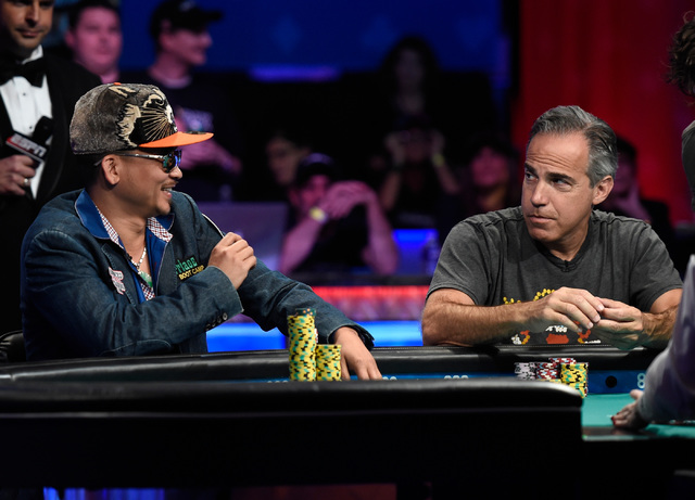 Qui Nguyen, left, of Las Vegas smiles at Cliff Josephy of N.Y. after winning a hand during the final table of the Main Event at the World Series of Poker at the Rio hotel-casino, Monday, Oct. 31,  ...