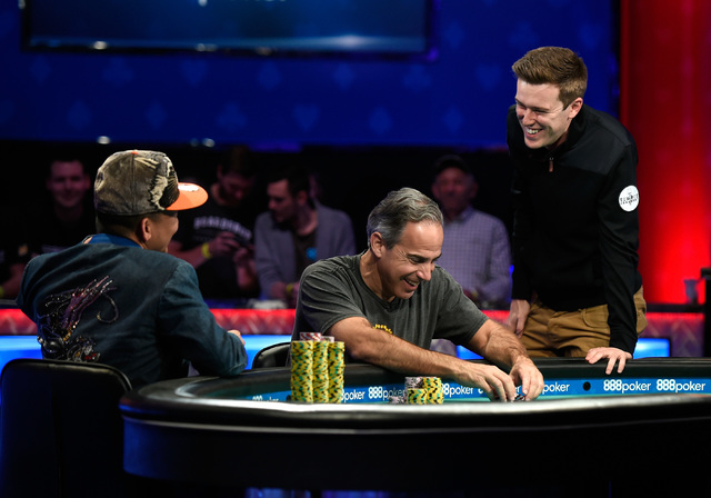 Players from left, Qui Nguyen of Las Vegas, Cliff Josephy of N.Y. and Gordon Vayo of San Francisco share a laugh after the suspension of play during the second night of the final table at the Main ...