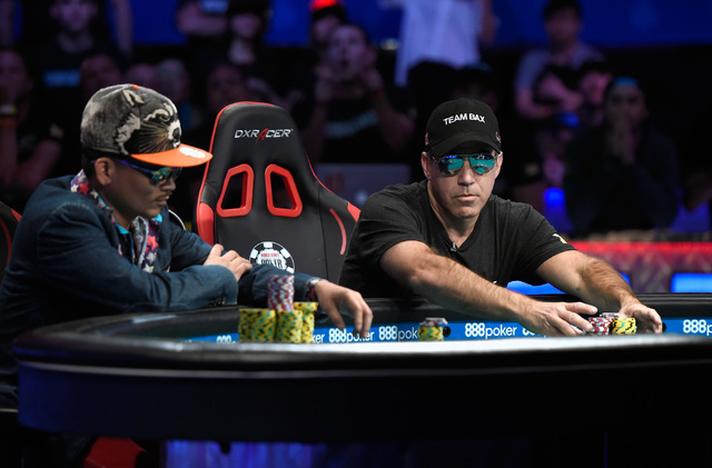 Cliff Josephy, right, of N.Y. pushes his chips for an all-in bet against Qui Nguyen of Las Vegas on the first hand of the night at the final table at the 2016 World Series of Poker Main Event at t ...