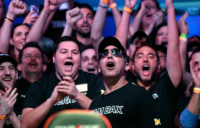 Cliff Josephy, second right, of N.Y. reacts with his supporters after winning an all-in bet against Qui Nguyen on the first hand of the night at the final table at the 2016 World Series of Poker M ...