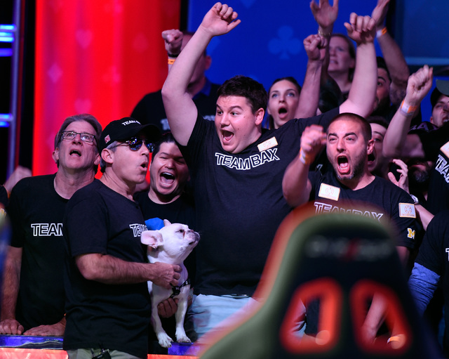 Cliff Josephy of N.Y. celebrates a winning hand with his supporters during the final table at the 2016 World Series of Poker Main Event at the Rio hotel-casino, Tuesday, Nov. 1, 2016, in Las Vegas ...