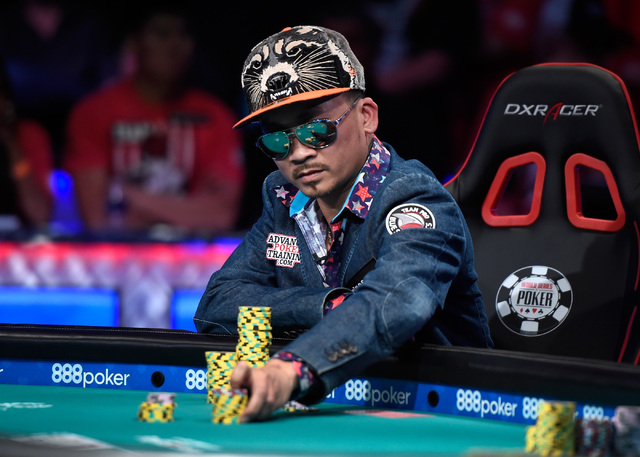 Qui Nguyen of Las Vegas places a bet during the final table at the 2016 World Series of Poker Main Event at the Rio hotel-casino, Tuesday, Nov. 1, 2016, in Las Vegas. David Becker/Las Vegas Review ...