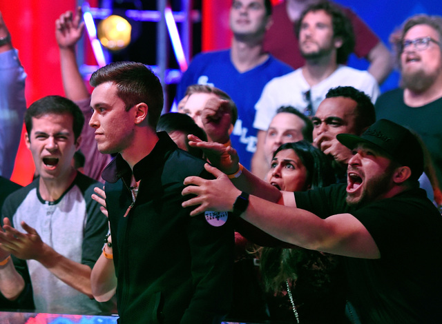 Supporters of Gordon Vayo celebrate  with him after knocking out Cliff Josephy after an all-in bet by Josephy during the final table at the 2016 World Series of Poker Main Event at the Rio hotel-c ...