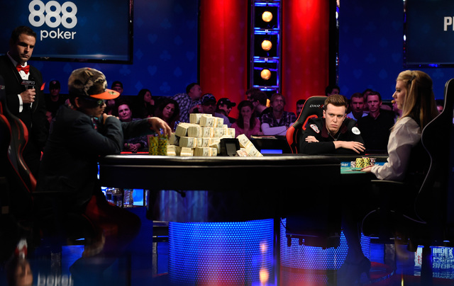Qui Nguyen, left, of Las Vegas and Gordon Vayo of San Francisco compete during the final table at the 2016 World Series of Poker Main Event at the Rio hotel-casino, Tuesday, Nov. 1, 2016, in Las V ...