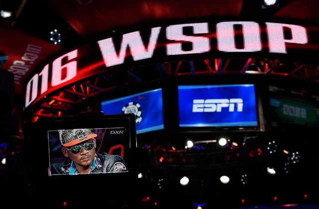 An image of Qui Nguyen of Las Vegas is displayed on a television camera monitor while he competes during the final table at the 2016 World Series of Poker Main Event at the Rio hotel-casino, Tuesd ...