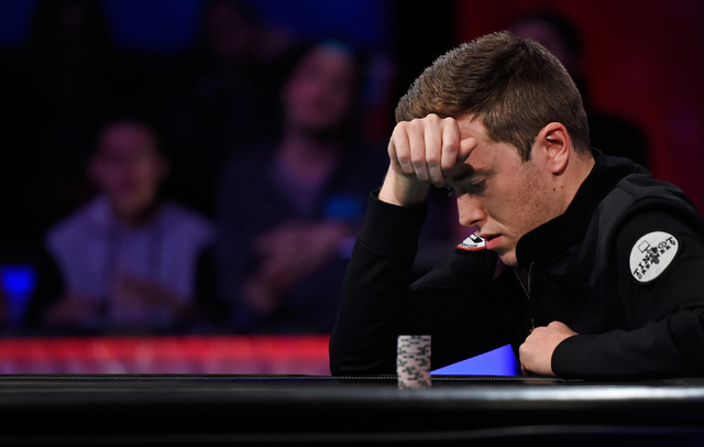 Gordon Vayo of San Francisco ponders to call an all-in bet during the final table at the 2016 World Series of Poker Main Event at the Rio hotel-casino, Tuesday, Nov. 1, 2016, in Las Vegas. Vado ch ...