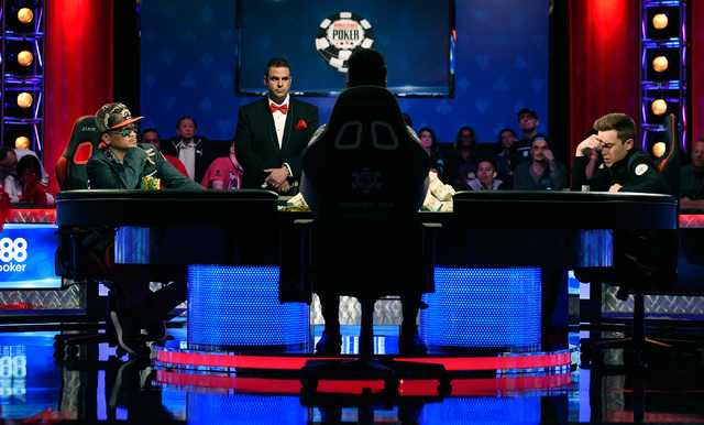 Gordon Vayo, right, of San Francisco ponders to call an all-in bet by Qui Nguyen of Las Vegas during the final table at the 2016 World Series of Poker Main Event at the Rio hotel-casino, Tuesday,  ...