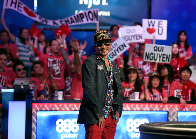 Qui Nguyen of Las Vegas waits for cards to be turned over during an all-in bet against Gordon Vayo of San Francisco during the final table at the 2016 World Series of Poker Main Event at the Rio h ...