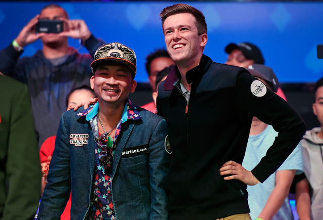 Qui Nguyen, left, of Las Vegas and Gordon Vayo of San Francisco wait for cards to be turned during the final table at the 2016 World Series of Poker Main Event at the Rio hotel-casino Wednesday, N ...