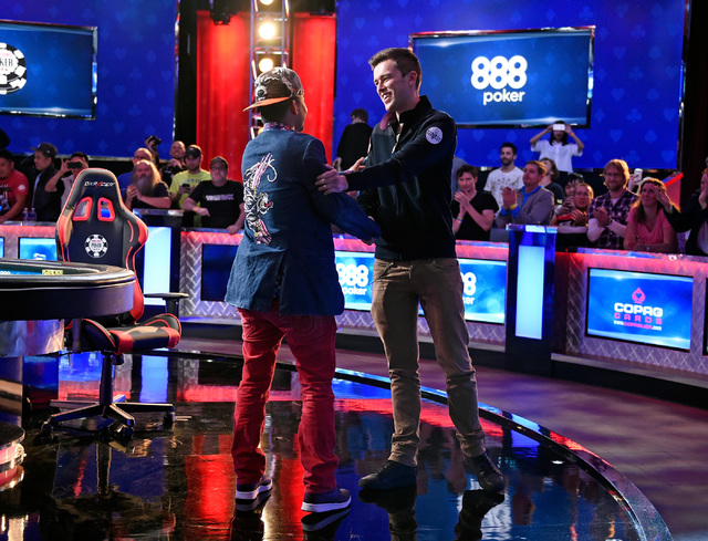 Qui Nguyen, left, of Las Vegas is congratulated by Gordon Vayo of San Francisco during the final hand at the final table at the 2016 World Series of Poker Main Event at the Rio hotel-casino, Wedne ...