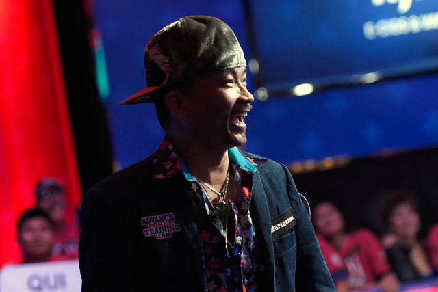 Qui Nguyen of Las Vegas is all smiles just before his first place victory at the final table at the 2016 World Series of Poker Main Event at the Rio hotel-casino Wednesday, Nov. 2, 2016, in Las Ve ...
