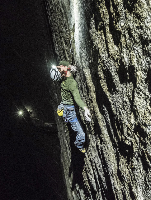 Adam Ondra climbs pitch 21 by headlamp on the Dawn Wall of El Capitan in Yosemite National Park, Calif. (Heinz Zak/Courtesy of Black Diamond Equipment via AP)