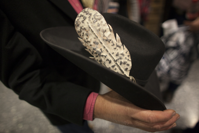Logan Martin shows off his metal feather at the National Finals Rodeo at Thomas & Mack Cent ...
