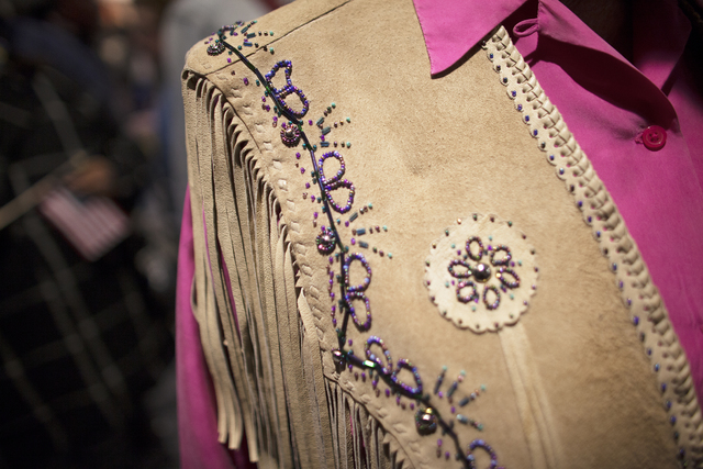 Mary Novak shows off her leather pancho at the National Finals Rodeo at Thomas & Mack Cente ...