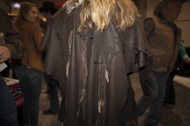 Shelly Weppler shows off her leather jacket at the National Finals Rodeo at Thomas & Mack C ...