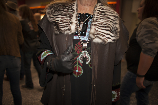 Shelly Weppler shows off her leather jacket and jewelry at the National Finals Rodeo at Thomas ...