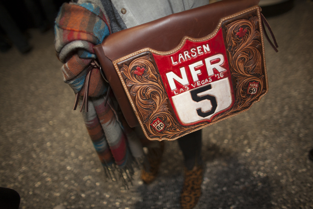 Alexis Minch shows off her bag at the National Finals Rodeo at Thomas & Mack Center on Sund ...