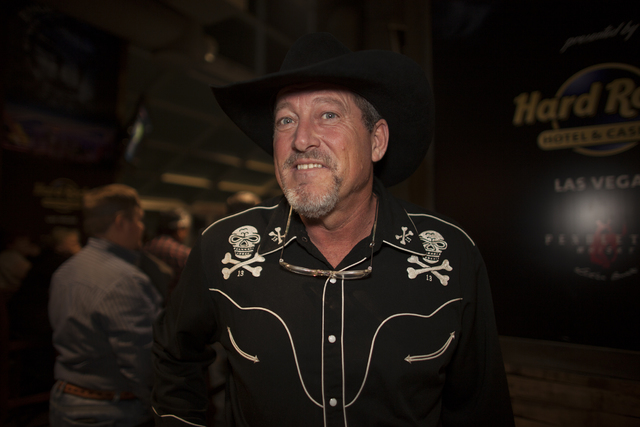 Greg McKinney shows off his skull and crossbones shirt at the National Finals Rodeo at Thomas & ...