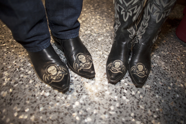 Greg McKinney and his wife Kelly wear matching skull and crossbones boots at the National Final ...