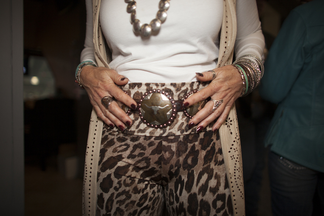 Kathy T. shows off her belt at the National Finals Rodeo at Thomas & Mack Center on Sunday, ...