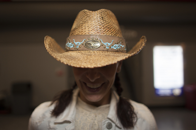 Ali Sherman shows off her hat at the National Finals Rodeo at Thomas & Mack Center on Sunda ...