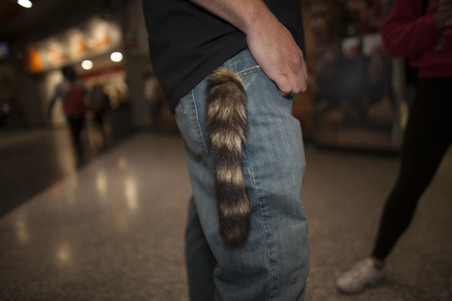John Sweet shows off his raccoon tail keychain at the National Finals Rodeo at Thomas & Mac ...
