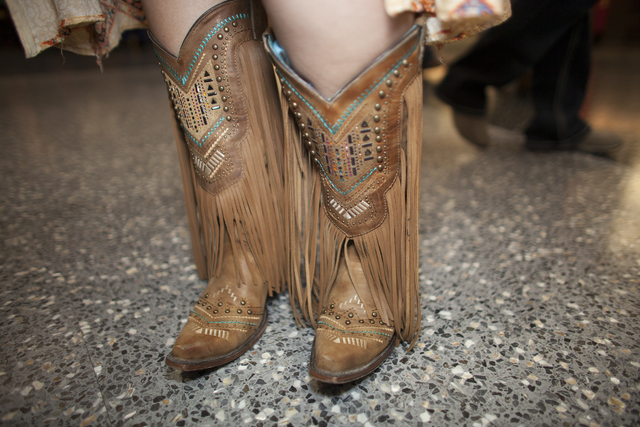 Jessica Thomas shows off her boots at the National Finals Rodeo at Thomas & Mack Center on ...