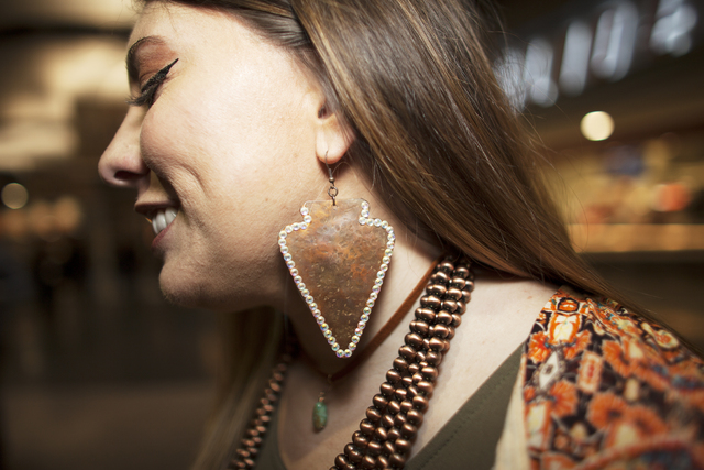 Jessica Thomas shows off her earring at the National Finals Rodeo at Thomas & Mack Center o ...