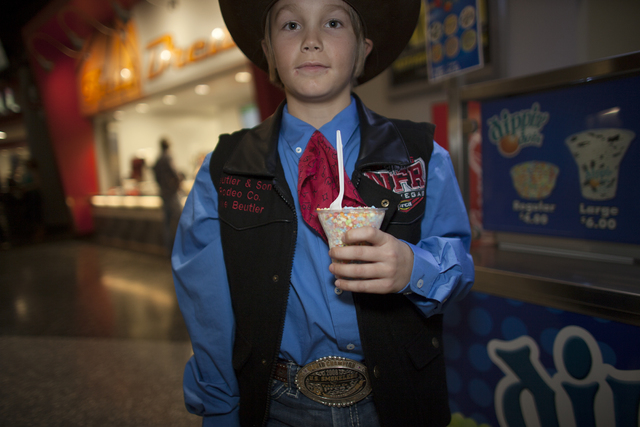 Jake Beutler shows off his vest and shirt combo at the National Finals Rodeo at Thomas & Ma ...