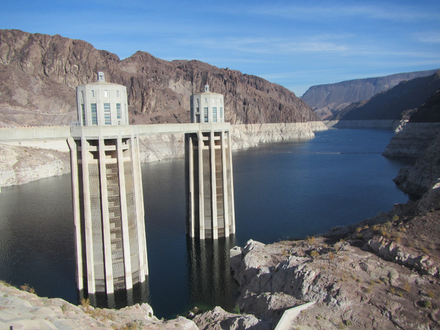 On Dec. 20, 1935, Patrick Tierney fell to his death from one of these intake towers on the Arizona side of Hoover Dam, pictured here on Dec. 13. His death is last fatal accident associated with th ...