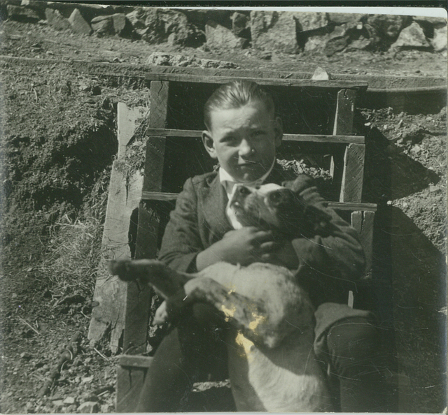 A young Patrick William Tierney holds his dog, Spike, in an undated photo. (Tierney family)